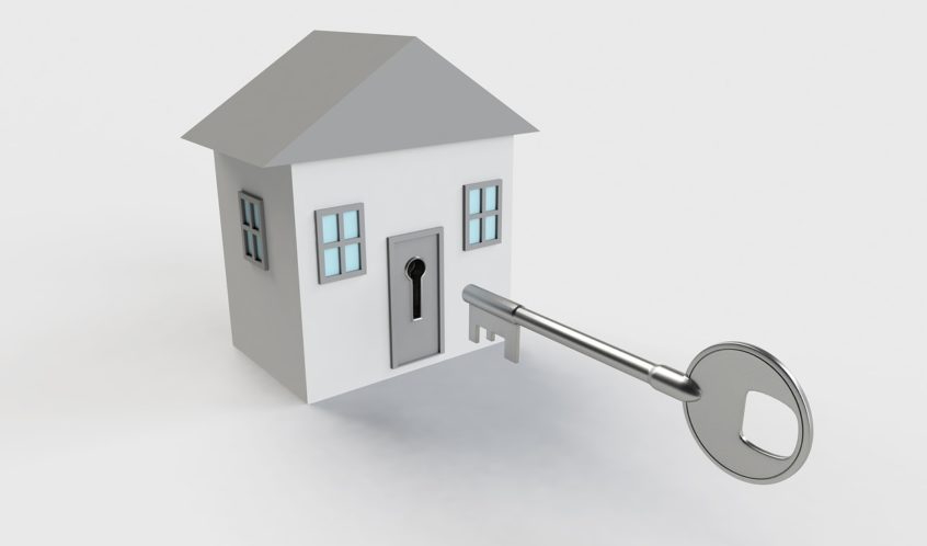 A large key fits the door lock - an invitation to work with Tina Vincent Real Estate Agent